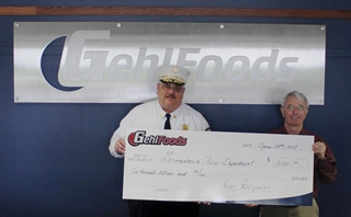 Gehl Foods Donates Check to Germantown Fire Department
